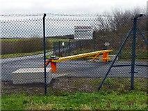 SJ7981 : Barrier at Manchester Airport Crash Gate #9 by Graham Hogg