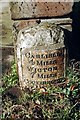 NY3552 : Old Milestone by the A595, Orton Grange Farm by CF Smith
