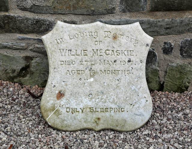 A memorial stone inside ruined Lennel Church