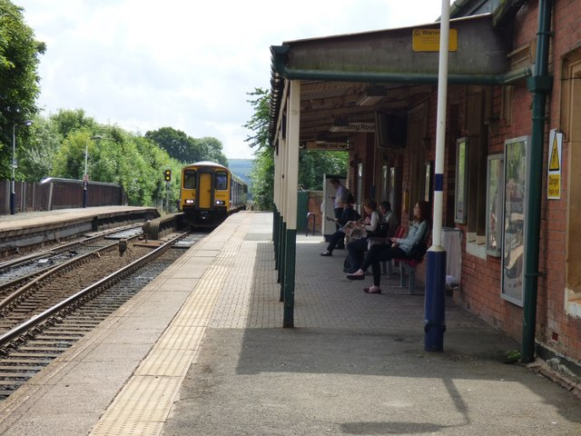 Train arriving at Romiley station