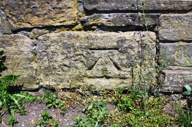 Benchmark on parapet of towpath bridge over Bradford Beck