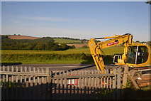 SX3358 : Yellow digger by the A374 by N Chadwick