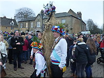 TL2797 : Straw Bear and dancers pose for photos - Whittlesea Straw Bear Festival 2018 by Richard Humphrey