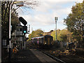 SJ9490 : Romiley station: train arriving from Manchester by Stephen Craven