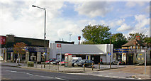 TQ2469 : Wimbledon Chase station, entrance on Kingston Road, 2003 by Ben Brooksbank