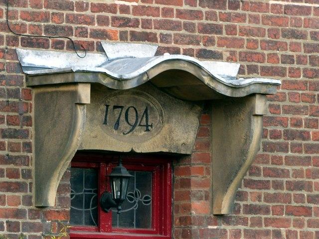 Porch with datestone at Derwent House
