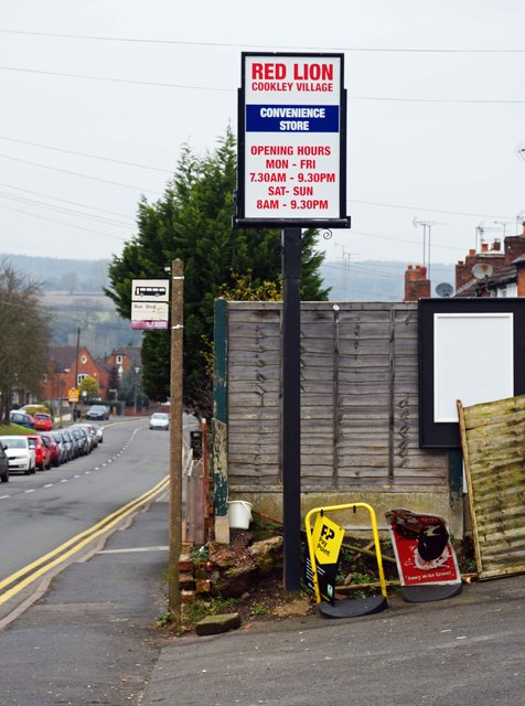 Bus stop & store sign outside 70 Castle Road, Cookley, Worcs