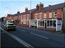 SJ3057 : Alyn Carpets shop, High Street, Caergwrle, Flintshire by Jaggery