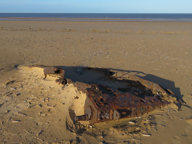 Army tank rusting on Titchwell beach in Norfolk