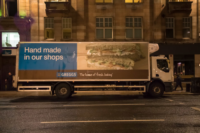 A Greggs night time delivery truck replenishing a store in Glasgow