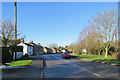 TL5078 : Witchford: Main Street on a winter morning by John Sutton