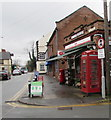 SJ3165 : Red phonebox on a Hawarden corner by Jaggery