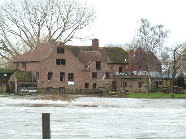 Fladbury Mill seen across a swollen River Avon