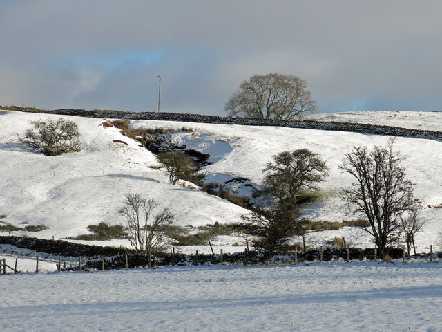 The valley of Shield Burn below Shieldburn Hall in the snow