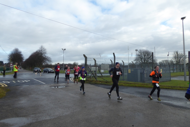Runners turning off Clotherholme Road
