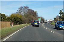 TL4097 : A141 nearing roundabout at Peas Hill by Robin Webster