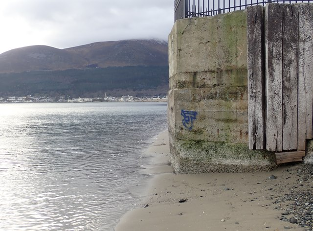 Gentle waves lapping around the base of the former WWII pillbox at the Slieve Donard Hotel