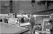 SP0686 : Working boatman at Gas Street Basin (1969) by Martin Tester