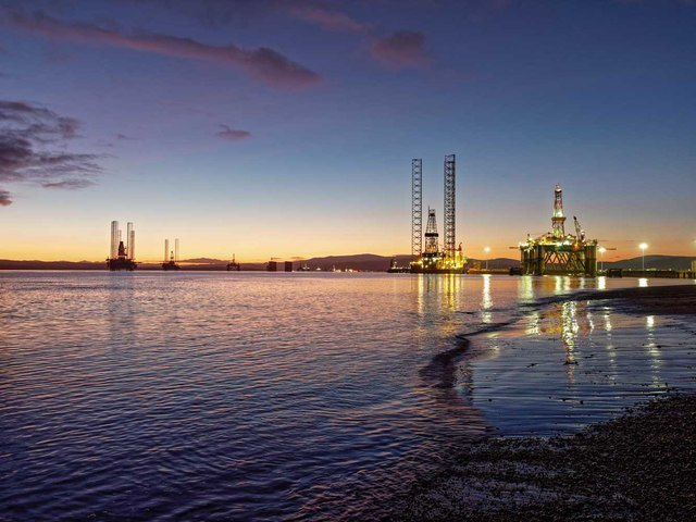 Oil rigs at sunset