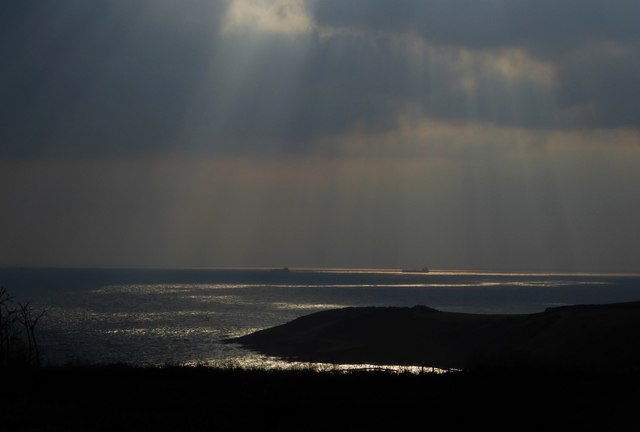 Shafts of sunlight over Falmouth Bay