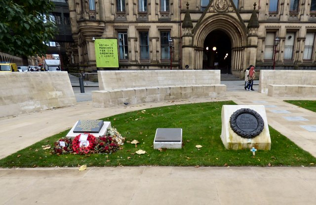 Small monuments outside Manchester Town Hall