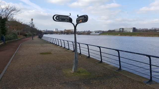 Cycleway signpost next to Infinity Bridge which spans the River Tees
