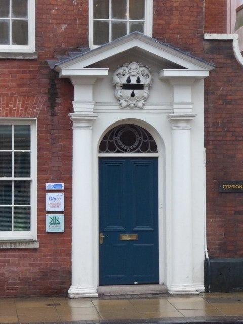 Door with Doric columns and armourial motif