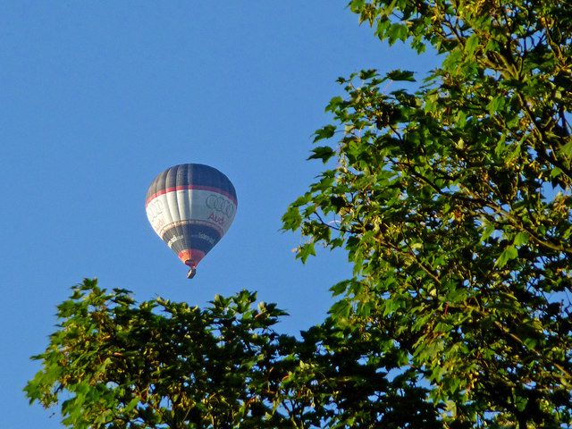 Hot air balloon over trees near Colwich, Staffordshire