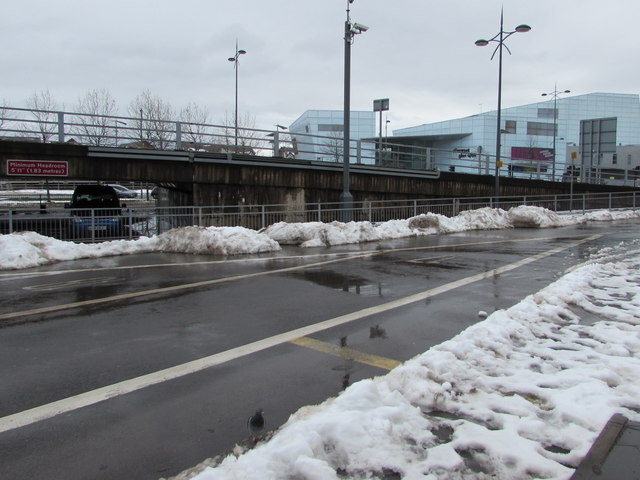 Small mounds of snow alongside the entrance to  Market Square bus station, Newport by Jaggery