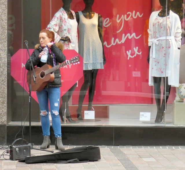 Busker outside M&S