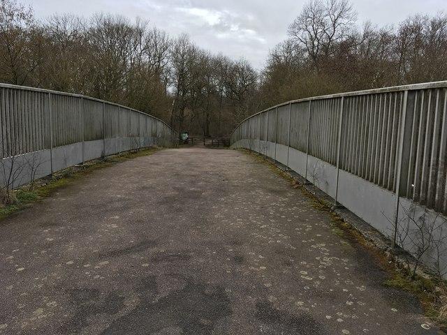 Footbridge into Howe Park Wood