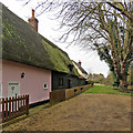 TL3444 : Kneesworth: plaster, weatherboarding and mossy thatch by John Sutton