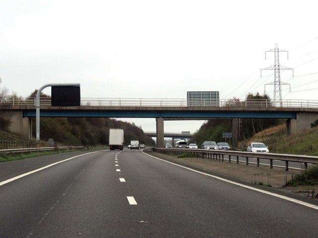 The M65 runs under a footbridge