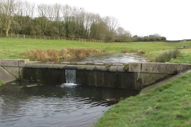 Weir and stepping stones on the balancing lake