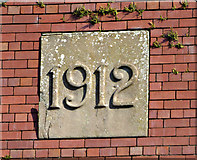 NS4865 : Date stone on former carpet factory by Thomas Nugent