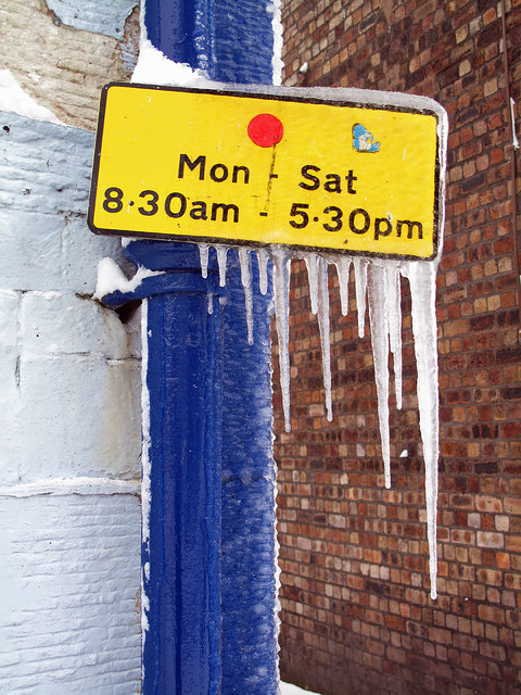 A frozen parking restriction sign
