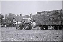 SJ6670 : Loaded trailer and tractor, Bridge End Farm, Davenham by Richard Sutcliffe
