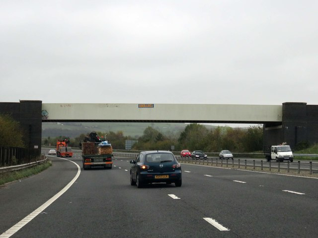 The M65 runs under a railway bridge