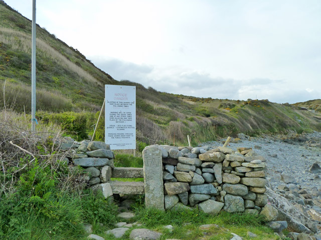 Stone stile and warning sign, coastal path