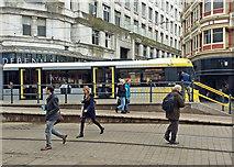 SJ8498 : Manchester: Metrolink tram at Market Street by John Sutton