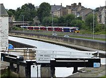 SE1039 : Train next to the Leeds and Liverpool Canal by Mat Fascione