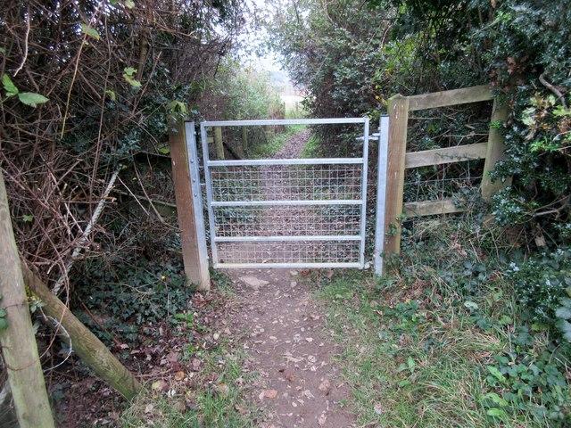 Metal gate across footpath