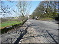 SE0335 : The A6033 at its junctions with Harry Lane and Dark Lane, Oxenhope by Humphrey Bolton