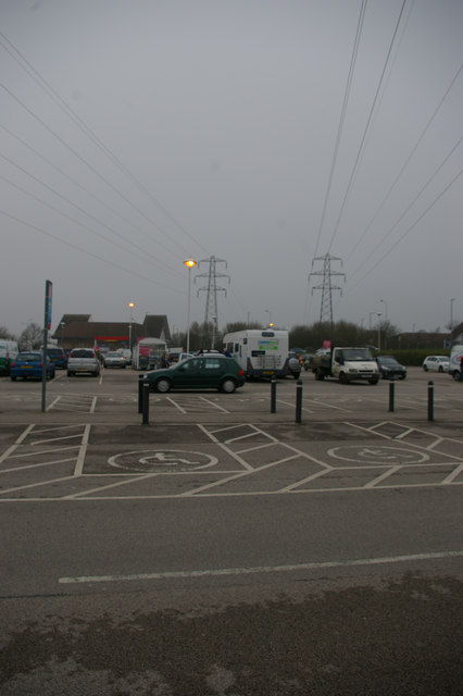Pylon lines crossing superstore car-park, Copdock