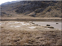 NM9199 : Tussocks and sand at the eastern end of Lochan nam Breac by Richard Law