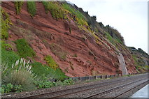SX9677 : Red sandstone cliff by railway line by N Chadwick