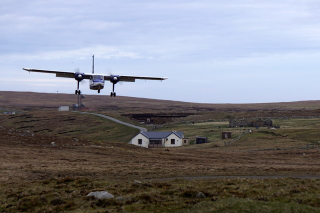 Britten Norman Islander approaching the airstrip on Foula