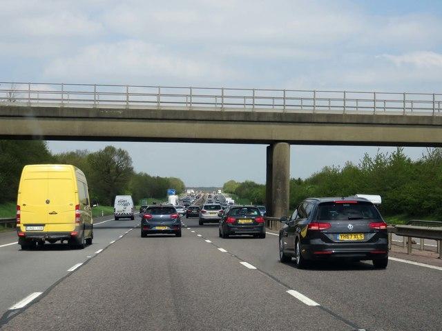 The M40 runs under a railway bridge