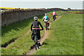 NU0249 : Cyclists on the Northumberland Coast Path by Walter Baxter