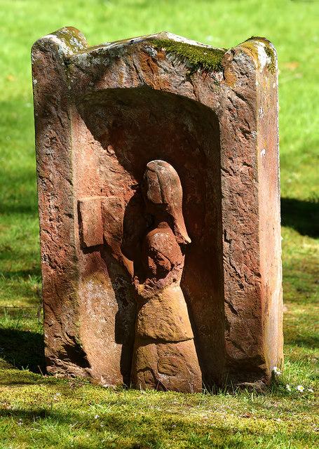 A symbolic portrait gravestone at Dryburgh Abbey